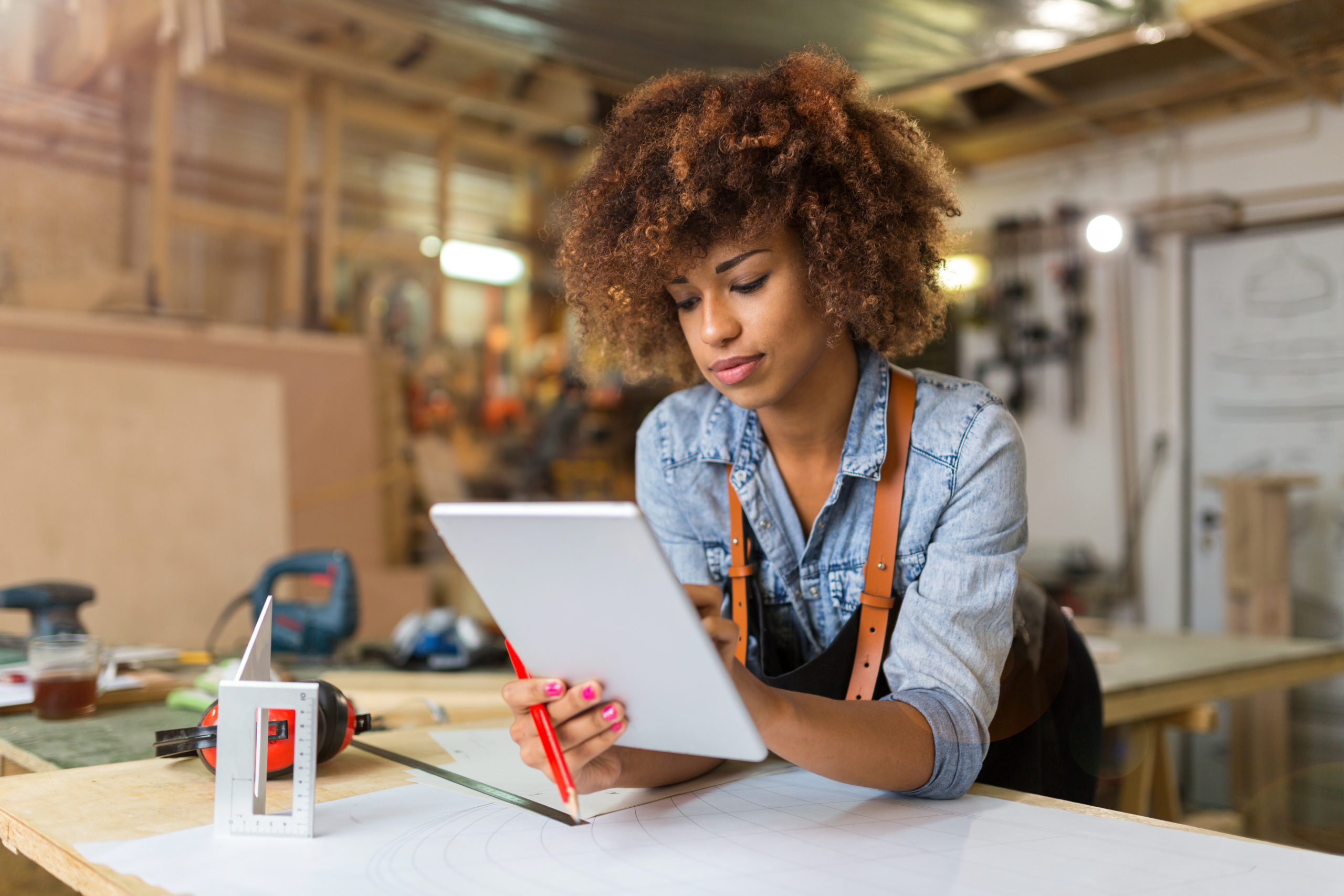 Young woman using a tablet in her workshop